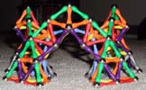 Front view of three pointed arches built of Mags construction toys