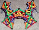 Upper front view of three pointed arches built of Mags construction toys