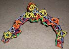 Third oblique view of a triskelion bridge built of Magz magnetic construction toys