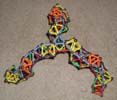 Fourth oblique view of a triskelion bridge built of Magz magnetic construction toys
