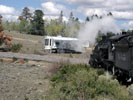 Steam locomotive about to obscure an RV